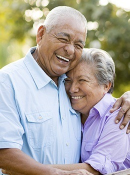 Smiling older man and woman outdoors